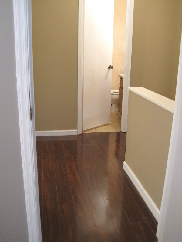 Upstairs Hallway Flooring Before and After  Ugly Duckling House