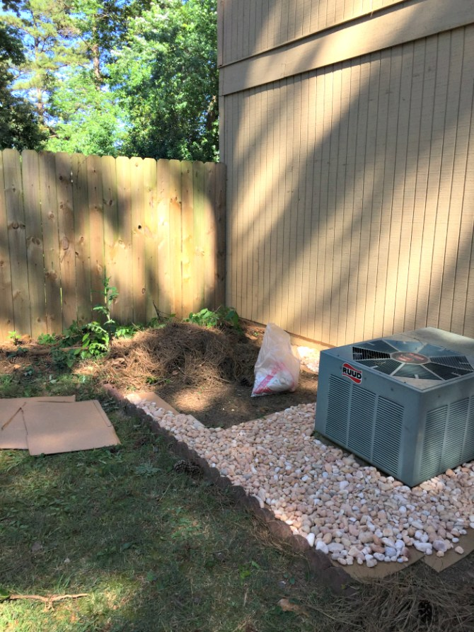 filling in ac unit area with landscaping rock