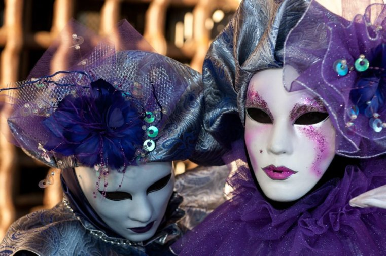 Venetian masks with dark eye sockets