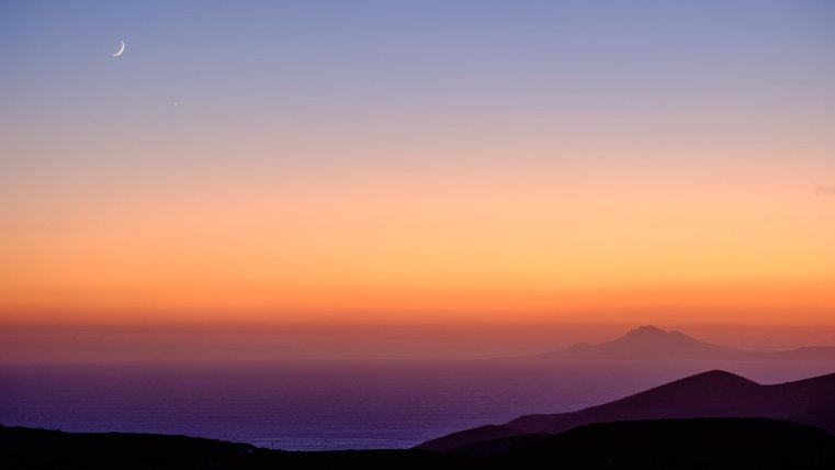 Sunset with crescent moon, Folegandros, Greece