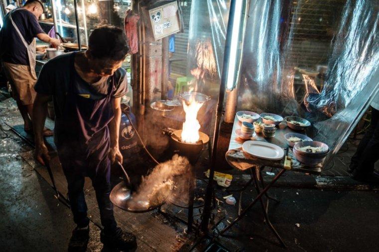 Frying noodles. Yaowarat Road, Chinatown, Bangkok