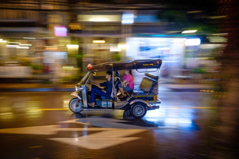 A tuk-tuk on a wet night in Chiang Mai, Thailand