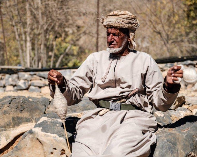 Man spinning wool, Jebel Shams, Oman