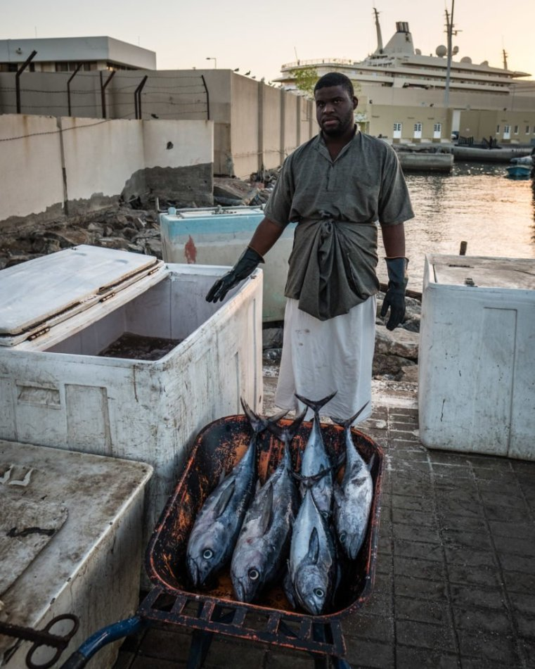 Offloading the catch of the day in Muttrah, Oman