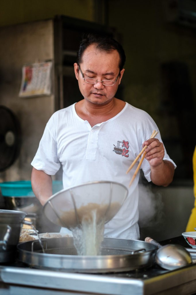 Straining noodles, Penang, Malaysia