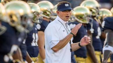 Sep 5, 2015; South Bend, IN, USA; Notre Dame Fighting Irish offensive coordinator Mike Sanford, Jr. watches warmups before the game against the Texas Longhorns at Notre Dame Stadium. Notre Dame won 38-3. Mandatory Credit: Matt Cashore-USA TODAY Sports