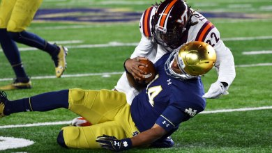 Notre Dame QB Deshone Kizer taking one of two uncalled helmet to helmet hits in 2016 contest with Virginia Tech