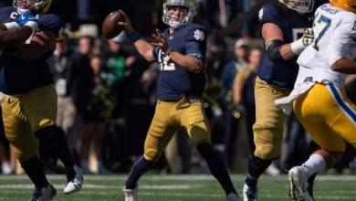 Notre Dame QB Ian Book in action vs. Pitt