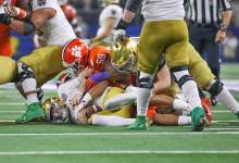 Notre Dame QB Ian Book sacked one of six times by Clemson.