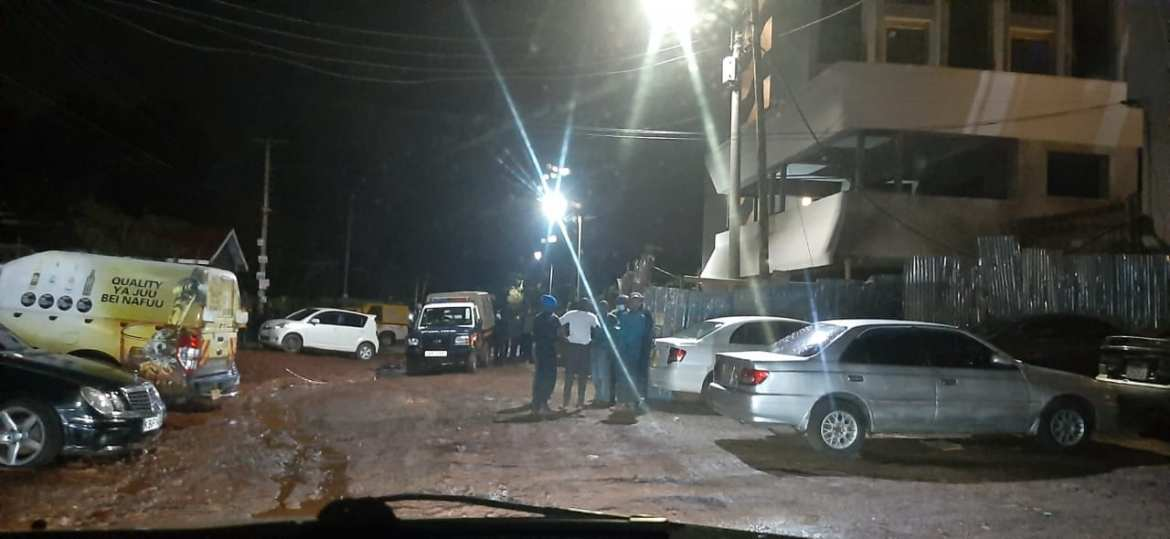 Police officers outside the Coral Bell apartments in Thindigua on Saturday night.