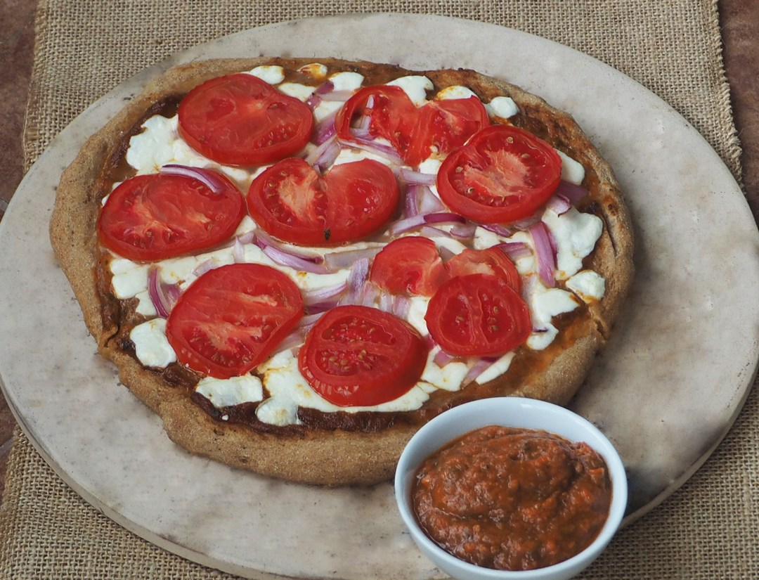 Homemade wholegrain pizza with home-made sauce