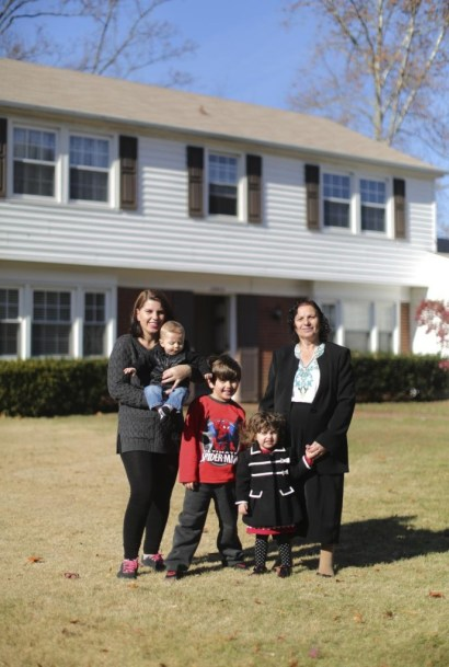 Zemrushe Shabiu in front of her newly-bought house in Maryland, USA, with her mother and children.