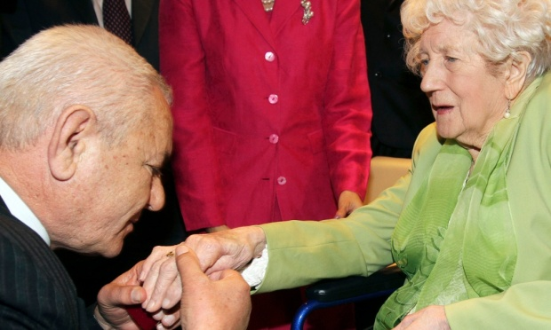 Xhemil Cala, whose father found Sgt John Thompson's ring, puts it on the finger of his sister, Dorothy Webster, 92, at a ceremony in Tirana. Photograph: Arben Celi/Reuters