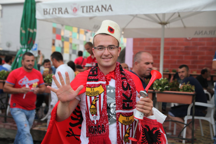 A fan of the Albanian soccer team KF Skenderbeu Korcë poses outside the Elbasan Arena, on August 5th, ahead of the team's tie against a Moldovan team.
