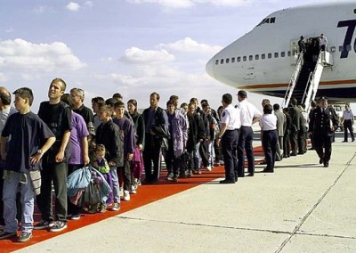 Kosovo Albanian refugees from Kosovo disembark from a trans-Atlantic charter flight at McGuire Air Force Base, N.J. More than 4,000 refugees reached safe haven at nearby Fort Dix in May. U.S. Army Photo