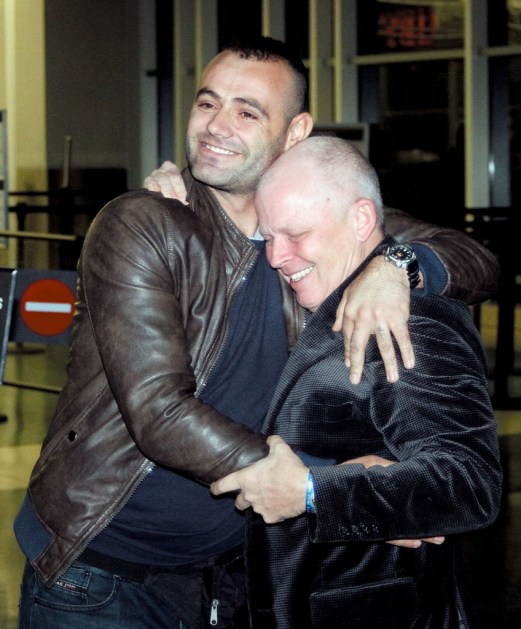 Michael Trost (right) and Alexander Peci hug after reuniting Monday at McGhee Tyson Airport. Peci, a former corporal in the Albanian military, and Trost with the U.S. Army, were both were badly wounded during an attack in Afghanistan in 2012.