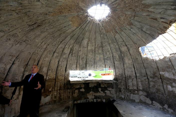 Albanian Besim Ndregjoni, a former political prisoner, stands inside an old bunker in Tirana. A formerly top-secret installation meant to keep Albania running after a nuclear attack is the latest relic of the country's dark Communist past being reinvented as a modern tourist attraction.