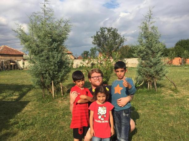 Rilind Abazi with three Syrian children in Kosovo.