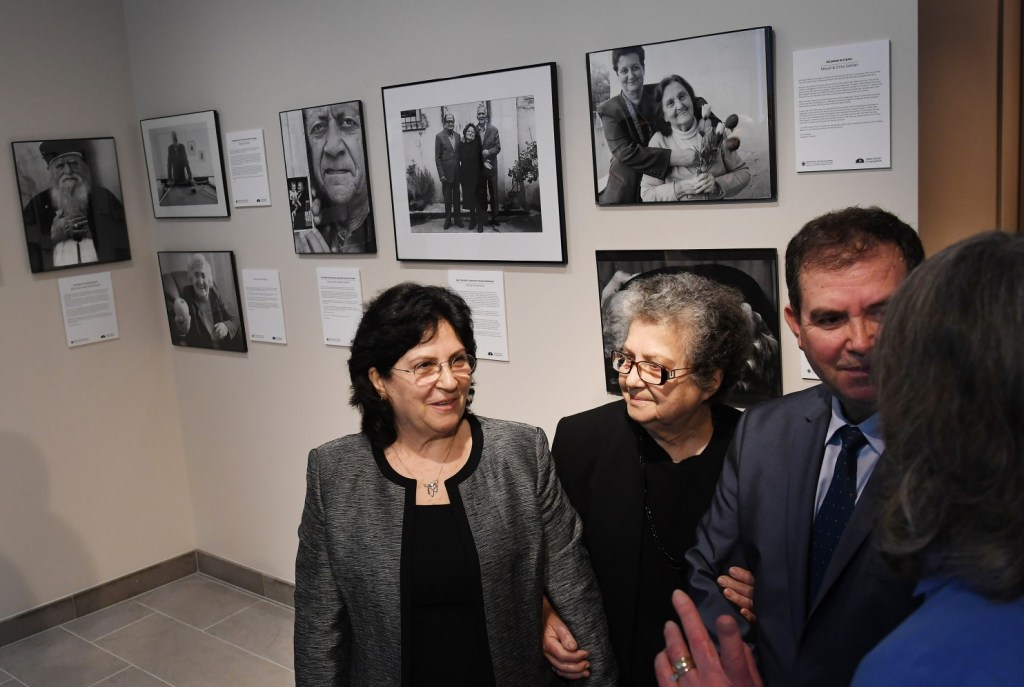 Drita Veseli, center, with daughter Ermira Hoxha and son Bujar Veseli, before the ceremony to honor her late husband and his family on Holocaust Remembrance Day at Adas Israel Congregation. (Matt McClain/The Washington Post)