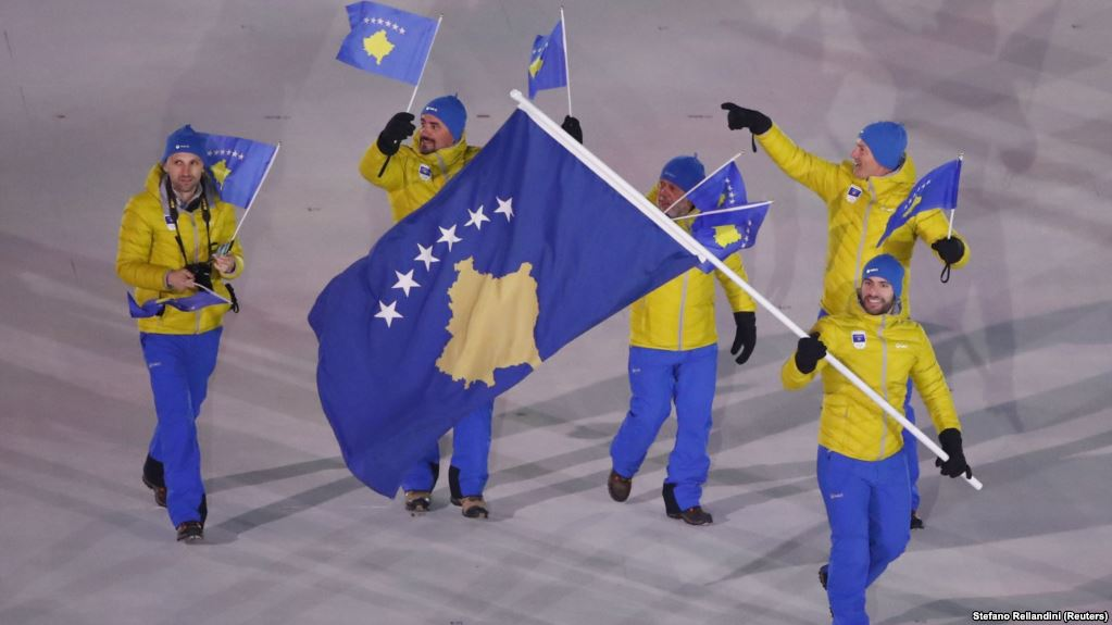 Albin Tahiri of Kosovo carries the national flag during the opening ceremony of the Pyeongchang 2018 Winter Olympic Games at the Pyeongchang Stadium on February 9.