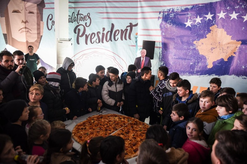 Children gather at a pizza party in honor of Donald Trump's presidential victory at a restaurant near Ferizaj, Kosovo on January 28, 2017.