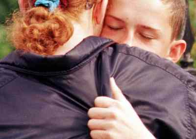 Alison Wilkinson says goodbye to a Kosovar friend at the Ulverston refugee centre in August 1999.