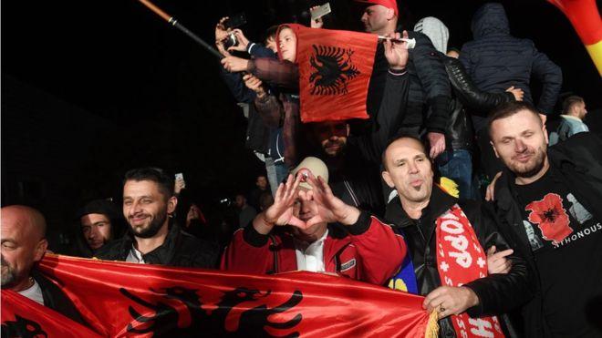 Vetevendosje supporters wave Albanian flags as they celebrate in the Kosovan capital Prishtina