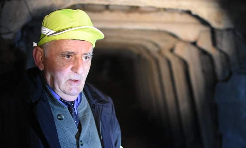 Feti Gjici in one of the tunnels. Photograph: Antonio Çakshiri