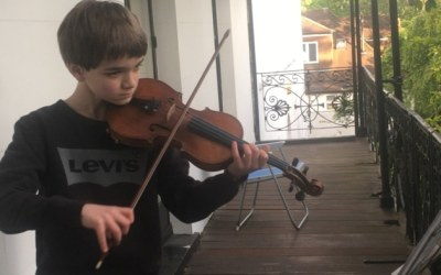 A British Albanian boy raises £1,000 for NHS with lockdown violin displays from Highgate balcony