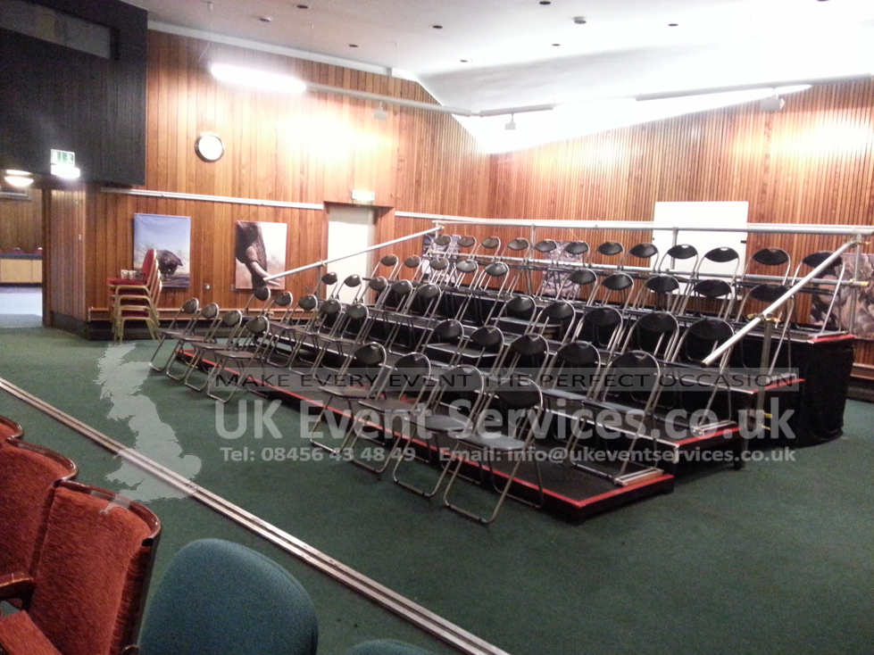 chair cover hire in birmingham grey rolling dining chairs uk event services - professional tiered stage platforms, seating banks, ...