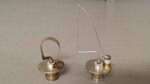 Internal coupling loop before (left side) and after modification work. The original loop was tuned to operate on 210MHz, but more important the shape is critical and the insertion of a tuning capacitor. This took many hours to perfect even with access to nice test equipment.