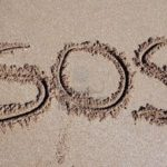 sos signal in the sand
