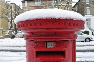 red letterbox with snow