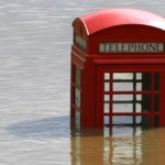 red telephone box in flood water