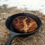 cooking bannock bread over open fire