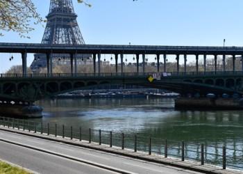 PARIS, FRANCE - APRIL 1: The George Pompidou's way is seen empty of cars near the Eiffel Tower after preventive measures against the coronavirus (COVID-19) were taken in Paris, France on April 1, 2020. ( Julien Mattia - Anadolu Agency )