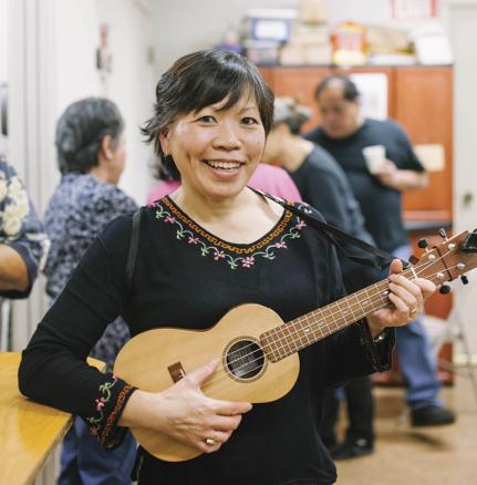 Katie Fong Taylor shows off her uke at the Ukulele Club of Chinatown in San Francisco