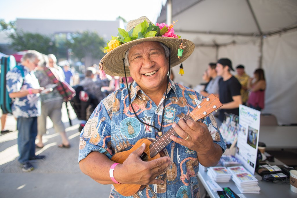I think this may be my favorite photo from the festival: Uncle Bobby showing off his Kamaka anniversary shirt from Reyn Spooner.