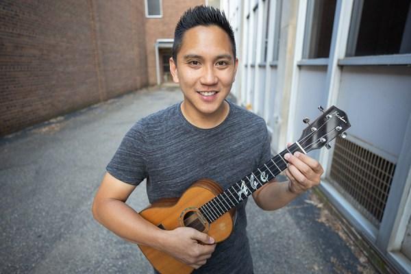 Abe Lagrimas, Jr. holding a ukulele