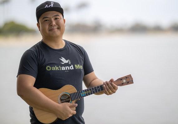 ukulenny holding a ukulele