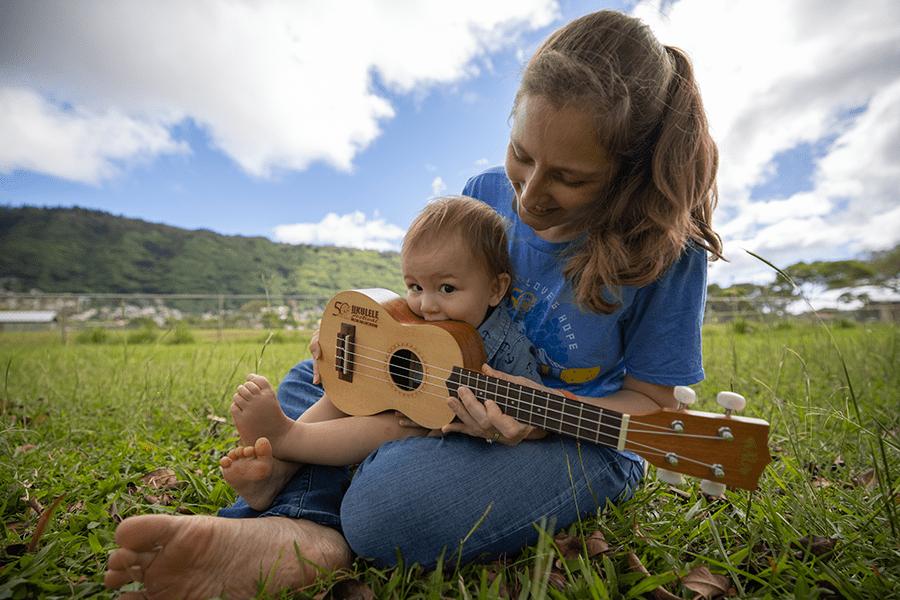 Sarah Maisel with Ukulele Festival Hawaii uke and son, Cameron