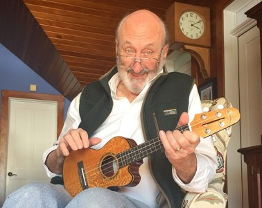 Noel Paul Stookey of Peter, Paul and Mary smiling and holding a ukulele