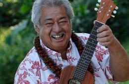 Hawaiian musician George Kahumoku holding a ukulele