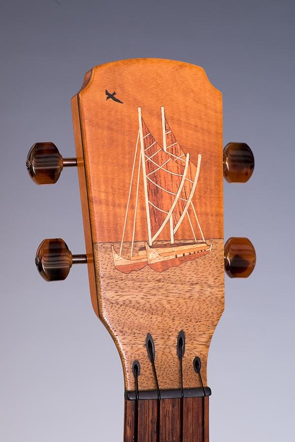little river ukuleles headstock with hawaiian canoe inlay
