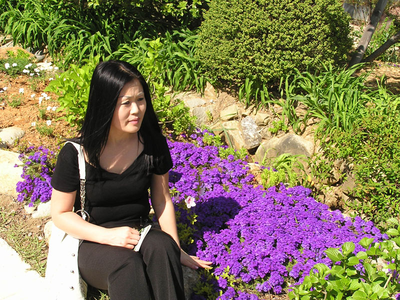 My wife, MyeongHee couldn't resist sitting among the purple