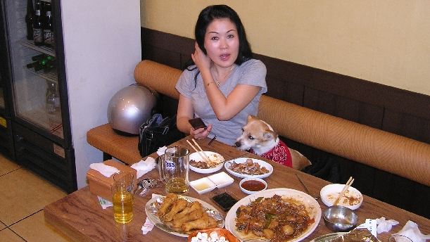 MyeongHee eats while my dog, SaTang, wants more chicken assholes