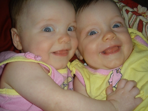 My twin granddaughters, Jillian(l) and Jenna(r), proof that I am a parent.