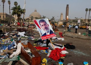 A man carries a poster of Egypt's ousted President Mohammed Morsi among deb