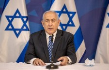 Israeli Prime Minister Benjamin Netanyahu issues a statement at the Israeli Defence Ministry in Tel Aviv on  July 27, 2020 following the high tensions with the Lebanese militant group Hezbollah at the Israeli-Lebanon border. (Photo by Tal SHAHAR / POOL / AFP)