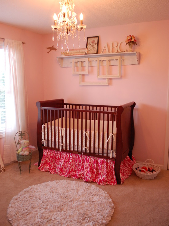Baby Girl Nursery With Pink Wall Accent And Mounted Nightlight